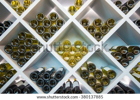 Wines White Wooden Shelve in Wines Cellar. Wines Selection.