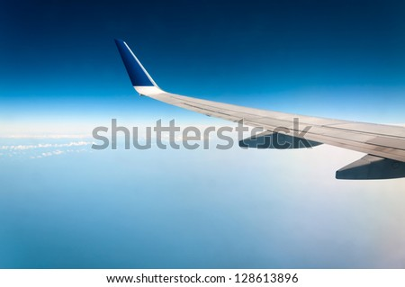 Wing aircraft in altitude during flight #128613896