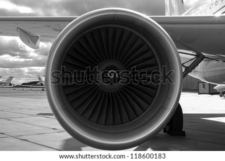 Wing and jet engine jet airliner black and white