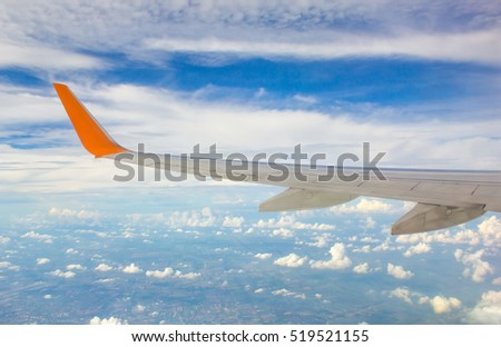 Wing of airplane from window #519521155