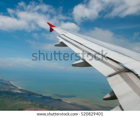 Wing of airplane from window #520829401