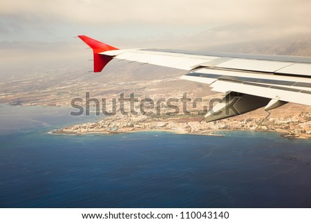 wing of airplane, island approach - stock photo
