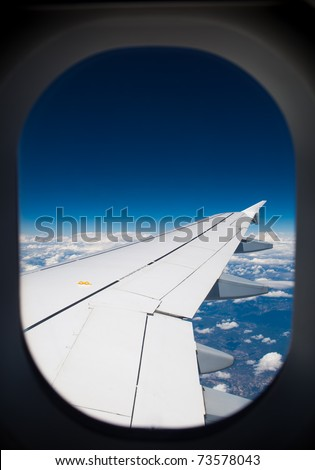 wing of airplane - view through the window