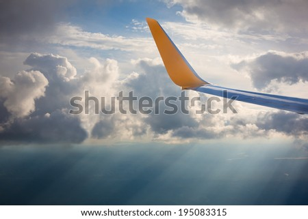 Wing of an airplane in the sunlights
