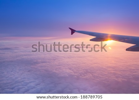 Wing of an airplane in the sunset #188789705