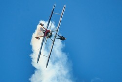 Wing Walker on Biplane come hurling toward the ground