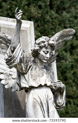 Winged angel statue.