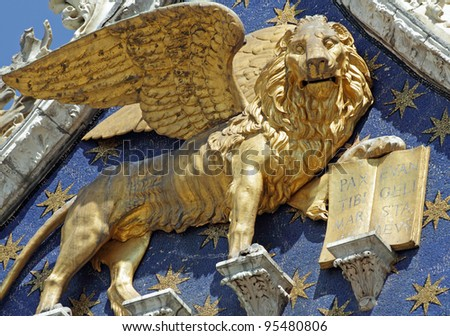 Winged Lion -  symbol of St Mark - with  book quoting :Pax Tibi Marce Evangelista Meus ( Peace to you Mark, my evangelist )  detail  from the facade of  San Marco Basilica in Venice, Italy, Europe