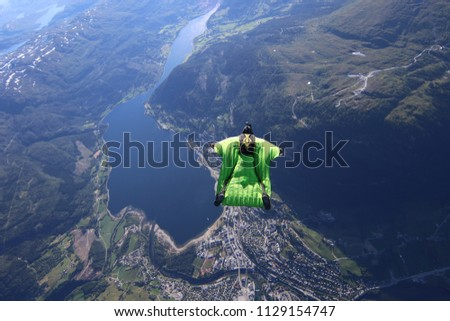 wingsuit flying over Voss, Norway #1129154747