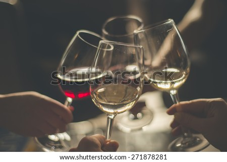 Wining with friends Four friends cheering Drinking wine in a restaurant #271878281