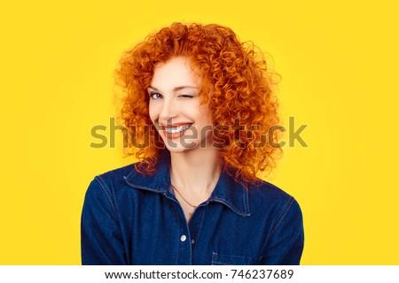 winking. closeup woman redhead...
