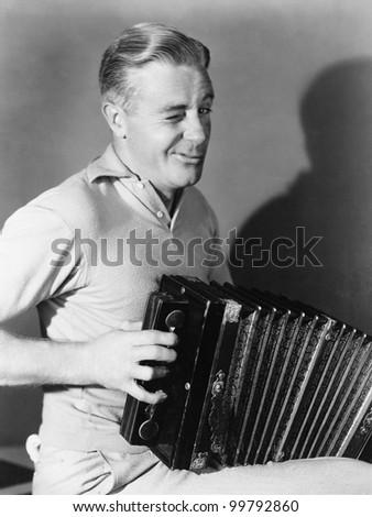 Winking man playing accordion