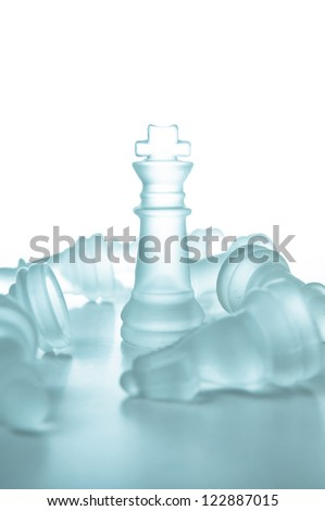 Winner and leadership concept, glass chess piece king on a white background isolated.