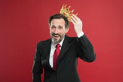 Winner at life. Successful prize winner putting crown jewel on head on red background. Best company award winner. Being a big winner.