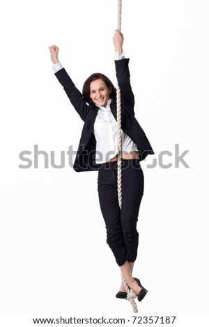 Winner business woman on the rope - stock photo