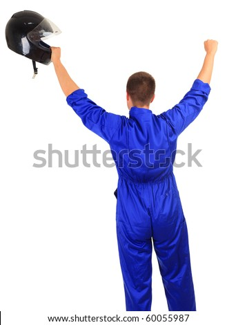 winner motorcyclist in blue coveralls with black helmet