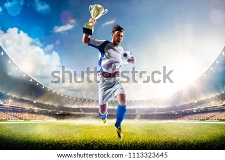Winner of soccer cup celebrates the victory #1113323645