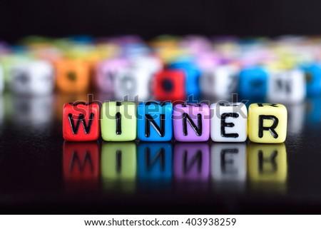 Winner on wooden table #403938259