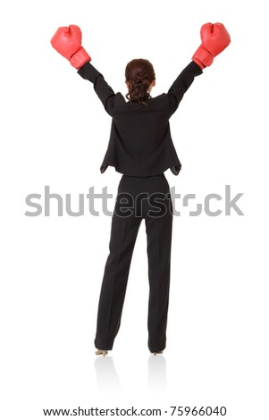 Winner, successful business woman raise hand with red boxing gloves, back view full length portrait isolated on white background.