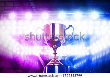 Winner trophy with lighting background stadium stage for e-sport,championship concept. Photo stock ©