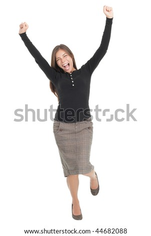 Winner woman. Casual young successful businesswoman jumping very excited. Isolated in full length on white background.
