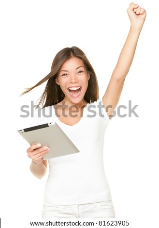 winner woman excited holding tablet pc isolated on white background. Cheerful happy fresh Asian Caucasian female model.
