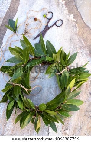 winner wreath of laurels on a stone plate  #1066387796