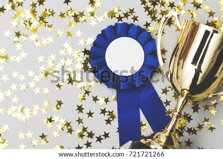 Winners background with trophy and rosette #721721266