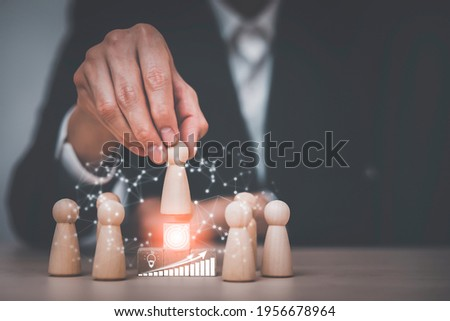 Winners figures on pedestal and losers on the floor, Leader figure standing out from the crowd on the wooden cube,  Leadership, and team. Boss and subordinates. Individuality and superiority. Stock photo ©
