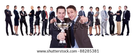 winning businessteam with two leaders, one holding a trophy, one pointing to you!