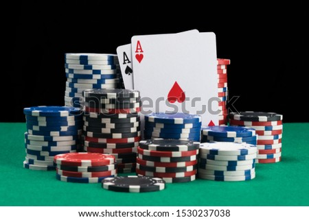winning cards and winning chips background a green poker table #1530237038