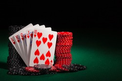 winning hands of cards.  gambling success and room in frame for text.