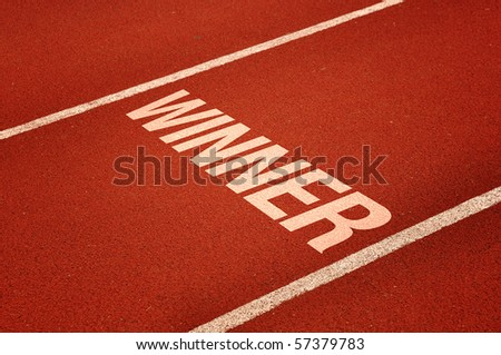 Winning lane, red tartan athletic track on the stadium. Sport winner concept.