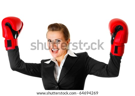 winning modern business woman wearing boxing gloves