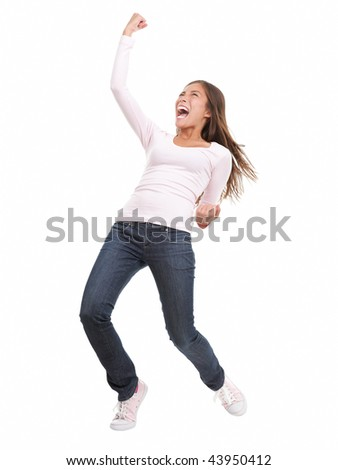Winning success woman in full length cheering and screaming of joy. Casual young mixed race chinese / caucasian isolated in full body on white background.