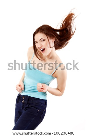 Winning teen girl happy ecstatic gesturing success. Isolated on white background.