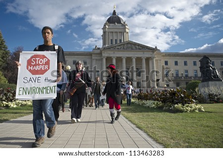 WINNIPEG, CANADA - SEPTEMBER 17: Daemon Bath leads a march departing the Manitoba Legislative Building marking the first anniversary of Occupy Wall Street on September 17, 2012 in Winnipeg.