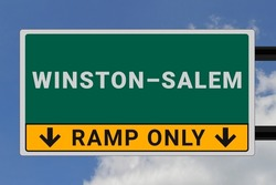 Winston–Salem logo. Winston–Salem lettering on a road sign. Signpost at entrance to Winston–Salem, USA. Green pointer in American style. Road sign in the United States of America. Sky in background