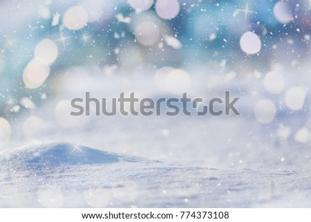 Winter abstract background, Colour glitters on snow. Christmas abrstact with shiny glitters #774373108