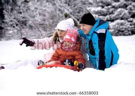 winter activities. family in the winter forest