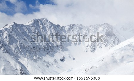 Winter Alps - Massif des Cerces mountain range in Rhone-Alpes region of France. European snow. #1551696308