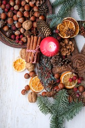 Winter altar for Yule sabbath. pagan holiday. Red candle, wheel of the year, cinnamon, nuts, cones, dry orange slices. Esoteric Ritual for Christmas, Yule, Magical Winter Solstice. flat lay