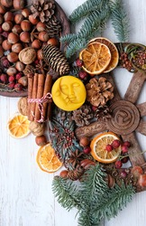 Winter altar for Yule sabbath. pagan holiday. Sun and moon symbol, wheel of the year, cinnamon, nuts, cones, dry orange slices. Witchcraft Ritual for Yule, Magical Winter Solstice. flat lay