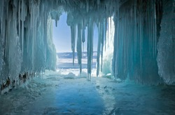 Winter at Lake Baikal. Icicles in the rocky caves