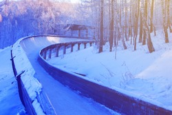 winter background bobsled track in the forest