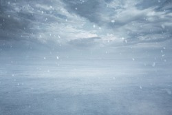 Winter background, empty frozen lake while snowing with copy space