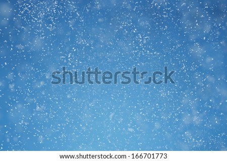 Winter background. Falling snow over blue background with copy space #166701773