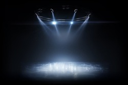 Winter background. Spotlight shines on the rink. Bright lighting with spotlights. Beautiful empty winter background and empty ice rink with lights