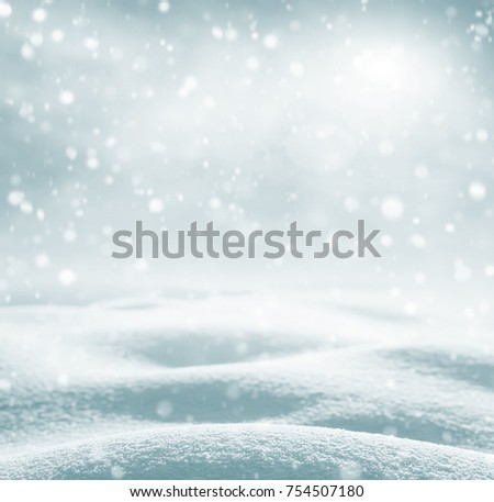 Winter background. Winter bright landscape with snowdrifts and falling snow. #754507180