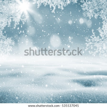 Winter background. Winter bright landscape with snowdrifts and falling snow. Branches of trees in hoarfrost. #535537045